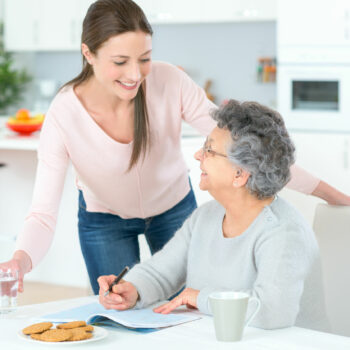 Carer helping woman at home